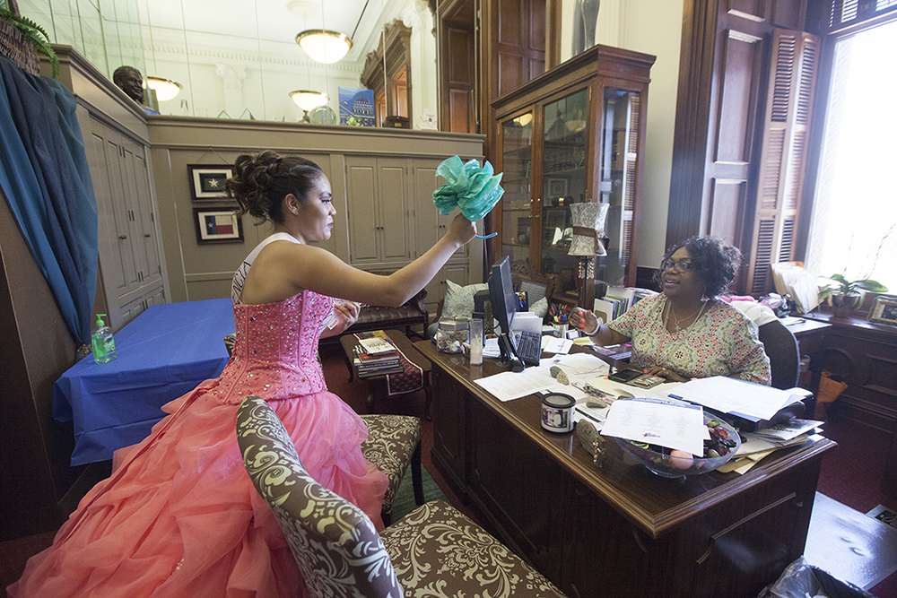 Alexandra Lopez delivers a flower to the staff of Representative Senfronia Thompson, who has worked to defeat SB4.